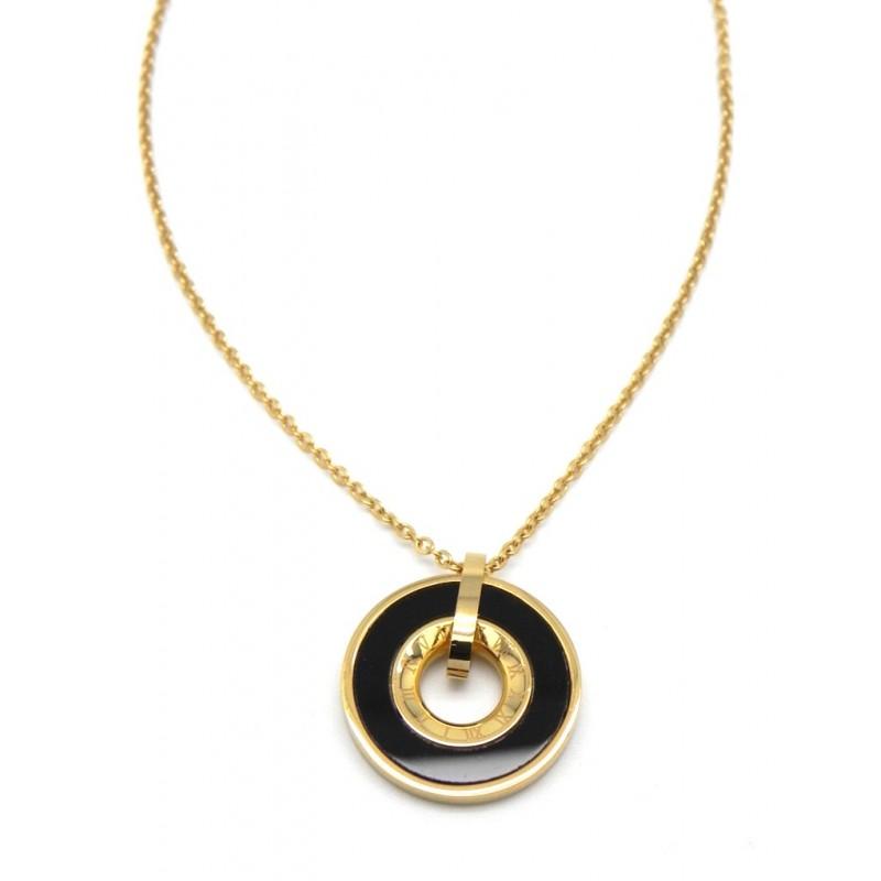 Collar dorado con rueda negra y numeros romanos